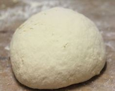 THE most amazing pizza dough ever ~ 1 cup of greek yogurt and 1 cup of Self Rising flour.....................that's it! This quantity makes a single pizza, but you can increase the ingredients and feed a crowd if you want to.