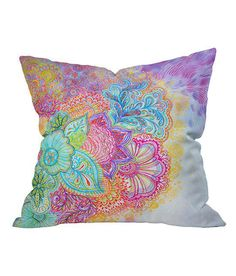 Soft colored floral pillow ==