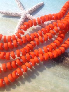 A personal favorite from my Etsy shop https://www.etsy.com/listing/233247989/orange-sea-glasscenter-drilled-heishi