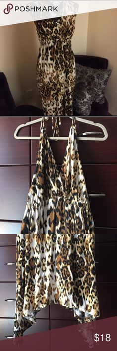 """Seven7 Halter Cheetah Dress Size 14/16 with 100% rayon stretch. Very soft & flowy fun cheetah print, long length tie halter, gathered stretchy waist bad(would be super cute as maternity dress too) dress down with jean jacket or vest and sandals or dress up with black blazer and heels👍🏼 dress is longer on the sides and shorter in the middle. Waist band lying flat 15""""(stretches to 21"""") and middle shorter length-from waist band(under boobs) 32"""", side lengths 41"""" EUC! Seven7 Dresses…"""