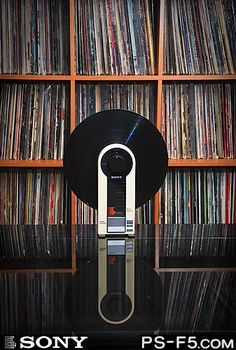 Sony PS-F5.  It's a linear, upright turntable, pretty sweet.  Would love to have this in the bedroom.  About $350 on ebay. Lo tengo es hermoso.