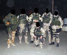 Special Forces Support Group working with SAS Task Force Black, in Iraq, dressed in a variety of camouflage patterns.