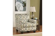 White with a blue and brown patterned accent chair for your living room décor