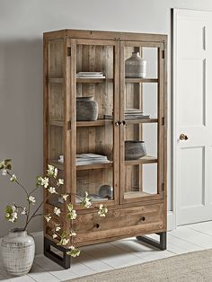 Embrace rustic style and solve all of your storage needs in one fell swoop with our fabulous tall cabinet with a visible wood grain. With a labyrinth of shelves, drawers and hidden storage, this large, striking piece will make an impact in your space. Loft Furniture, Cabinet Furniture, Living Furniture, Painted Furniture, Furniture Design, Furniture Storage, Furniture Online, Furniture Outlet, Luxury Furniture