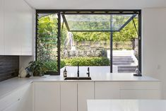 Bring the outside in! Streamlined kitchen, soft close drawers, skylights and a stunning hydraulic window leading to the garden. Living Area, Living Spaces, Black Subway Tiles, Closed Kitchen, Black Sink, Skylights, Timber Flooring, Large Windows, Stunning View
