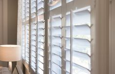 The strengths that best define quality plantation shutters plantation shutters living room with tan walls and white shutters. Cafe Shutters, White Shutters, Wood Shutters, Traditional Shutters, Tan Walls, Energy Efficient Lighting, Hanging Shelves, Simple House, Window Coverings