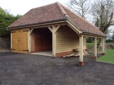 Oak framed Double cartlodge with log store in Kersey, Suffolk. Built by SuffolkCartLodges.