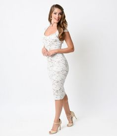 Reap something radiant! Presenting a retro ravishing fitted frock in an off white crochet fabric.