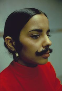 "Credit: Courtesy Galerie Lelong, New York and Paris and Alison Jacques Gallery, London  Untitled Facial Hair Transplant, Moustache (1972) ""In her photographic self-portraits, she pressed her face against glass to distort her features or pictured herself dripping in blood or disguised as a man with glued-on facial hair."""