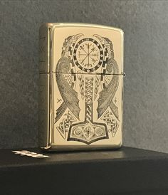 Hand engraved Viking themed zippo lighter by sls hand engraving
