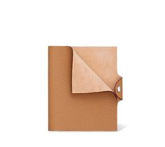 """Hermès Ulysse leather notebook cover in natural sand 5.3"""" x 6.3"""" Leather tab with silver and palladium snap closure, Togo calfskin. Ref. H036986CK21 $230.00"""