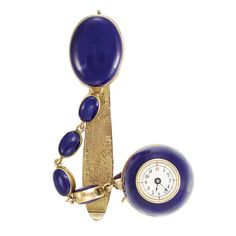 Antique Gold and Blue Enamel Lapel-Watch, Patek Philippe & Co.  Gilt full plate movement, topped and joined by one large oval gold panel applied with blue enamel, joined by 5 smaller oval double-sided gold and blue enamel panels, suspending a ball watch applied with blue enamel, bisected by two gold bands, centering a circular dial with Arabic numerals, unsigned, three spoke balance, no. 39727, circa 1871, with metal clip. With original signed fitted box.