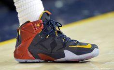 LeBron James wearing Blue/Red-Yellow Nike LeBron XII 12 PE on October 30, 2014