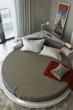 The Modrest Plato Modern White Round Bed is perfect for any outside the box individual! Its unique yet still functional.