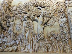 Sculpted plaster relief. Partial view of the fireplace mantle.