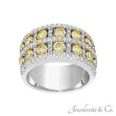 "Fancy Yellow Diamonds and White Diamonds "" Stepping Stones"" Fine Jewelry Band."
