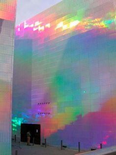 "ianbrooks: "" Holographic Cube Building by Hiro Yamagata Originally made for the Guggenheim Bilbao Museum, this installation covered two buildings in holographic panels that shifted color once lasers. Yamagata, Bilbao, Instalation Art, Rainbow Aesthetic, Purple Aesthetic, Oeuvre D'art, Modern Architecture, Building Architecture, Chinese Architecture"