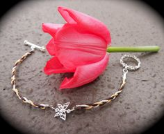 Triple stranded braided bracelet with butterfly clasp. Beyond cute! from Amateur Armour (sandy@amateurarmour.com)