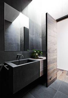 Mink Grey American Oak timber door created by Robson Rak Architects – Malvern. Looks gorgeous in this moody bathroom.: