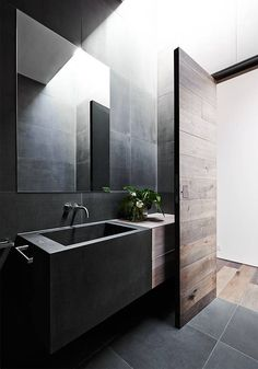 Mink Grey American Oak timber door created by Robson Rak Architects – Malvern. Looks gorgeous in this moody bathroom.: