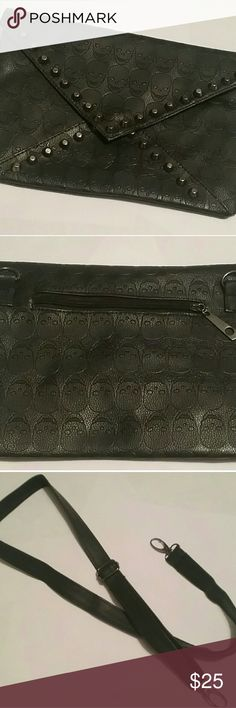 💀black studded skull clutch💀 very cool black studded skull clutch features two pockets- one on the inside and one on the back. only used once- excellent condition! comes with crossbody strap! 💀 Bags Travel Bags