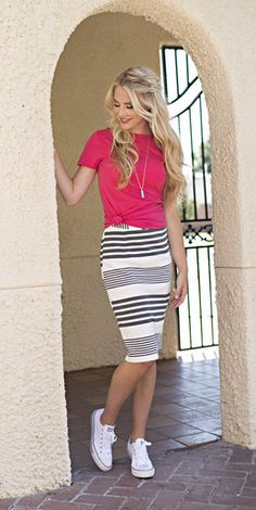 A striped knit pencil skirt with an elastic waist. This skirt is a little longer than the average pencil knee length skirt.  Modest skirt,  pencil skirt, striped skirt,  modest fashion, casual skirt