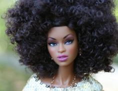black barbie with a curly fro.