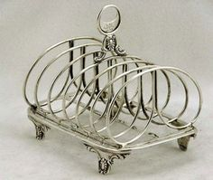 English sterling silver toast rack from 1938. Need one of these for my mail.