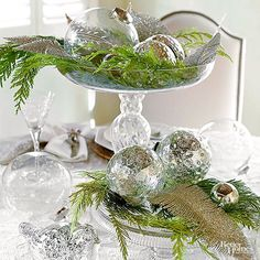 Turn to your tree for this simple DIY centerpiece. Clip a few branches and place them on tiered cake stands. Then top the greenery with mercury-glass globe ornaments.