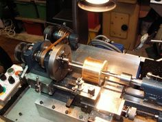 Cowell's lathe is cutting a screw thread on to a clock barrel so that the weight line does not tangle and stop the clock, a grandfather clock in this case. Small Lathe, Lathe Accessories, Clock Repair, Industrial Machine, Grandfather Clock, Assemblages, Assemblage Art, Machine Tools, Milling