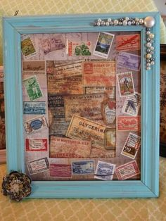 Distressed frame with vintage jewelry and postage stamps