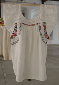 Oaxacan Blouse Mexico - what interests me here are the bands of whitework.  You could use your machines built-in stitches in rows.  Also, gussets.