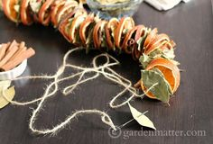 This dried orange garland project made with bay leaves, and cinnamon sticks is easy to create, and make a beautiful statement in your fall or winter decor.