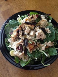 Spinach and Kale salad topped with chicken breast and poppyseed dressing