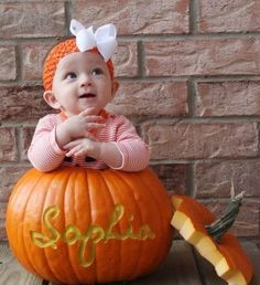 I'm all about pictures of babies in pumpkins. Do the kids names on it and take a picture of the kids and their pumpkins all together..  We could do this for Miah.