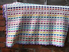Ravelry: I Love Scraps Afghan pattern by Mary Ann Frits  (I've made baby afghans using 122 chains to start and using baby, sport, or worsted yarn depending on yarn available at the time and the desired finished size -- I used one row single crochet for the border then 1 row reverse single crochet.)  Easy 3 row repeat, so an easy afghan to make while watching TV or listening to an audio book!