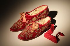 Ecclesiastical (possibly cardinal's) red velvet shoes with rich gold thread embroidery. | c. 1840-1860