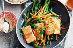 Sesame seeds top the charts for vitamin E, and they're so easy to sprinkle over any dish. Try adding them to this light Asian meal of crisp-coated tofu with a tangy sesame dressing and crunchy salad.