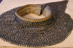 An aventail or camail is a flexible curtain of chainmail that covers the neck and shoulders.