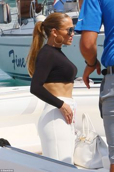 Star power: Jennifer wore a long sleeved top, which also flaunted her fabulous physique, on a yacht on Sunday