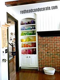Coolest ombre rainbow glass shelf idea ever! Most of the colored glass is from the thrift store!