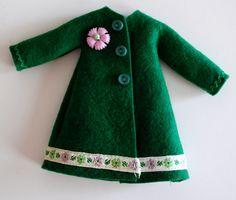 Dark green Blythe doll mod coat. $5.00, via Etsy. I love the ribbon at the bottom. <3