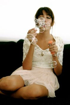 Blowing bubbles would be a cute idea maybe?