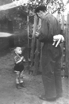 Man Giving His Son A Puppy, 1955 (source)