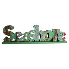 "Seashore Table Décor - Bring a touch of seaside-inspired style to your home with this charming accent, artfully crafted for lasting appeal. Construction material: MDF. 5"" high x 17.75"" wide x 2"" deep ($13.95/$19.00 retail)"