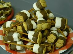 Made for a camping themed day at our playgroup, these are a simple and fun variation of a yummy s'more ! Simply stick a pretzel stick into a marshmallow and dip into melted milk chocolate. Before the chocolate dries, stick a teddy graham onto the wet chocolate. Then set on a piece of parchment paper lined baking sheet and either let chocolate harden at room temp or pop in the fridge for it to set up more quickly. Then enjoy !