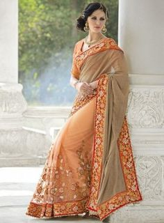 #Peach and #Taupe Fancy net Embroidered #Saree Features a fancy net half and half saree with dhupian silk blouse.