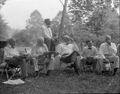 Henry Ford (the founder of Ford Motor Co.), Thomas Edison (inventor of the phonograph, motion picture camera and the practical light bulb), Warren G. Harding (29th president of USA) and Harvey Samuel Firestone (founder of Firestone Tire and Rubber Co.) lounging together. - Google Search