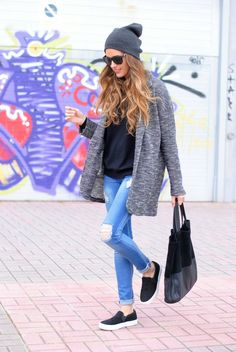 Shop this look on Lookastic:  https://lookastic.com/women/looks/coat-turtleneck-skinny-jeans-slip-on-sneakers-tote-bag-beanie-sunglasses/5639  — Charcoal Beanie  — Black Sunglasses  — Black Turtleneck  — Grey Coat  — Black Slip-on Sneakers  — Black Suede Tote Bag  — Light Blue Ripped Skinny Jeans