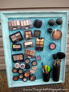 Fabric covered metal in a newly painted frame, $store magnets glued to the back of makeup and small brush-holder containers.  LOVE!!  Laura Thoughts: Make-up Magnet Board